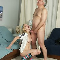 Adorable petite blonde girlie shows her dad how well she can handle cock