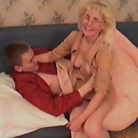 Blonde oldie goes for a ride on her sonny's shaft and takes it from behind